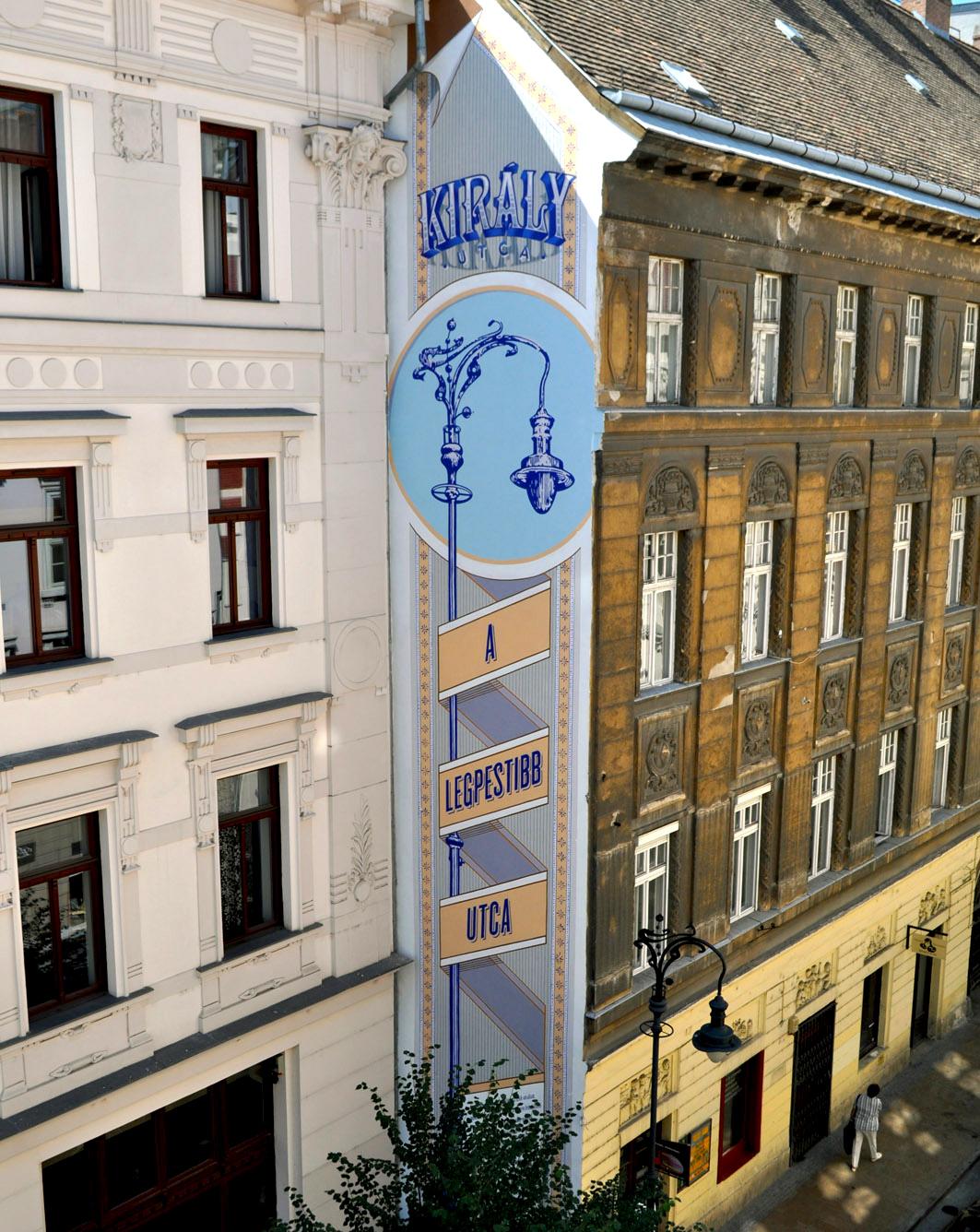 neopaint works - tűzfalfestmény - dekorációs falfestés - épület díszítőfestés